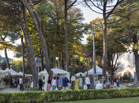 RIMINI, ITALY - SEPTEMBER 24, 2016: Unrecognized people walk in the Federico Fellini Park. Rimini is one of the most famous Adriatic Sea resorts in Europe thanks to its 15 km long sandy beach.