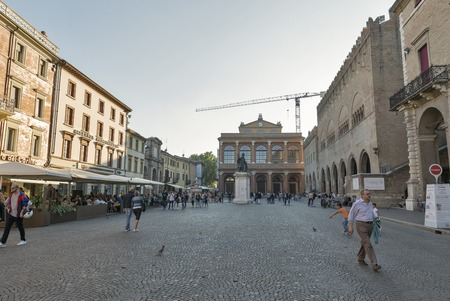 RIMINI, ITALY - SEPTEMBER 25, 2016: People walk along central city square Piazza Cavour. Rimini is one of the most famous Adriatic Sea resorts in Europe thanks to its 15 km long sandy beach.