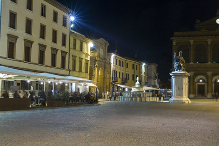 cavour: Cavour square with statue of Pope Paul V, Pigna fountain and public theater Amintore Galli at night in Rimini, Italy. Editorial