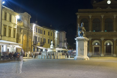 Cavour square with statue of Pope Paul V, Pigna fountain and public theater Amintore Galli at night in Rimini, Italy. Editorial