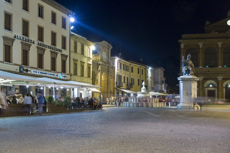 RIMINI, ITALY - SEPTEMBER 25, 2016: Cavour square with statue of Pope Paul V, Pinecone fountain and public theater Amintore Galli at night. It is one of the main hubs of city life in historic center.