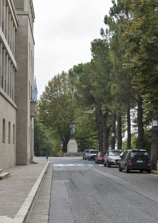 political economist: SAN MARINO REPUBLIC - SEPTEMBER 26, 2016: Viale Antonio Onofri with statue of economist Melchiorre Delfico. Republic of San Marino is a small country in Apennines, the third smallest country in Europe Editorial