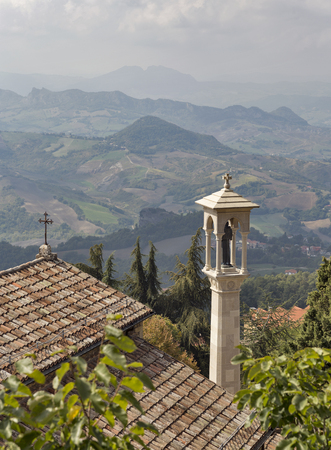 Chapel in San Marino fortress against the sky and landscape view from above.