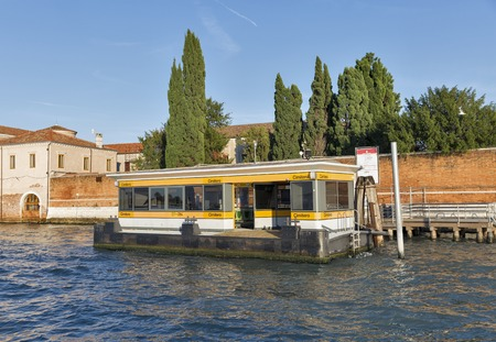 VENICE, ITALY - SEPTEMBER 22, 2016: Cemetery water bus station on San Michele cemetery island. Venice is situated across a group of 117 small islands that are separated by canals and linked by bridges Editorial