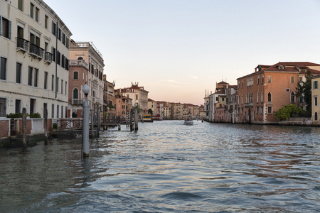 water bus: Venice canal at sunset, Italy Stock Photo