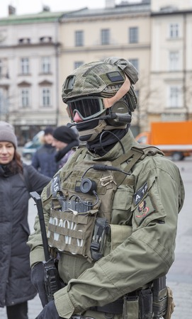 strengthening: KRAKOW, POLAND - JANUARY 14, 2017: Welcome to American troops on Krakow Market Square during picnic Secure Poland dedicated to arriving of soldiers for strengthening of the eastern flank of NATO.