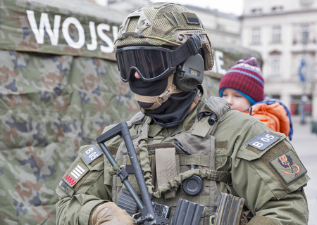 KRAKOW, POLAND - JANUARY 14, 2017: Welcome to American troops on Krakow Market Square during picnic Secure Poland dedicated to arriving of soldiers for strengthening of the eastern flank of NATO.