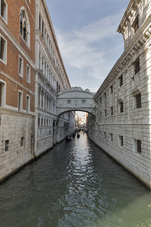 Gondolas in canal and Bridge of Sighs at Doges Palace, in Venice, Italy