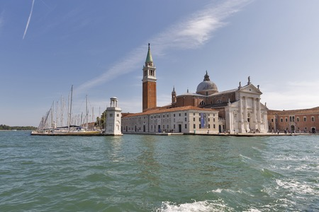 VENICE, ITALY - SEPTEMBER 23, 2016: Unrecognized people visit church of San Giorgio Maggiore. Venice is situated across a group of 117 islands that are separated by canals and linked by bridges.