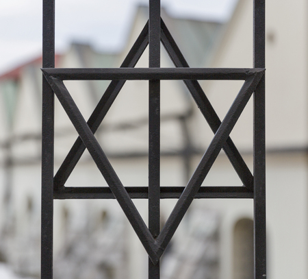 szeroka: Metal grille in the form of six pointed star of David closeup in the Kazimierz, Jewish quarter of Krakow, Poland.