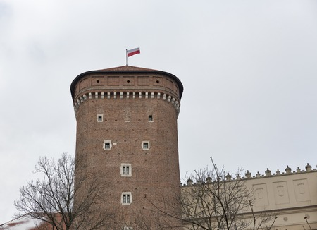 Wawel Royal castle Senator tower with Polish flag in Krakow, Poland.