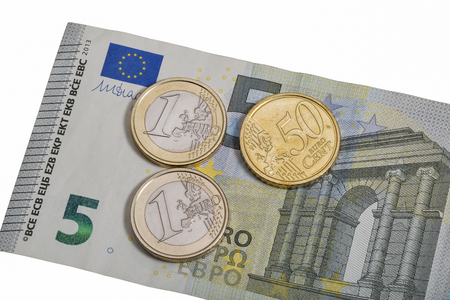euromoney: Five euro banknote with one euro and fifty cent coins isolated on white background macro Stock Photo