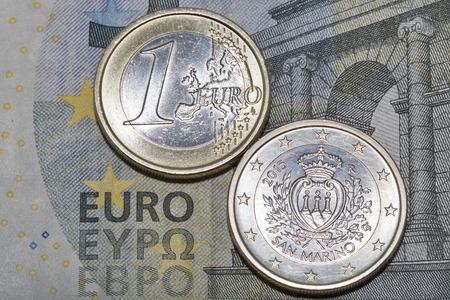 euromoney: Five euro banknote with one euro San Marino coins macro Stock Photo