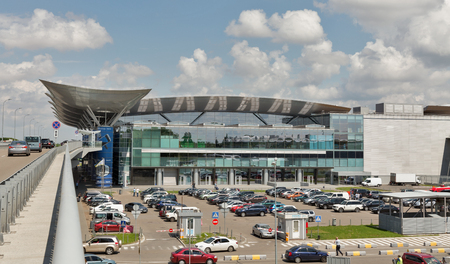million: BORYSPIL, UKRAINE - MAY 13, 2016: Car parking of Boryspil International Airport. It is the countrys largest airport, serving passenger air traffic with over 8 million passengers per year. Editorial