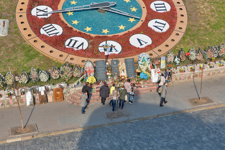 KIEV, UKRAINE - OCTOBER 16, 2015: Unrecognized people visit memorial to the Hundred of Heaven Heroes, victims of anti-president and anti-government protests EuroMaidan on Institutska street. Editorial