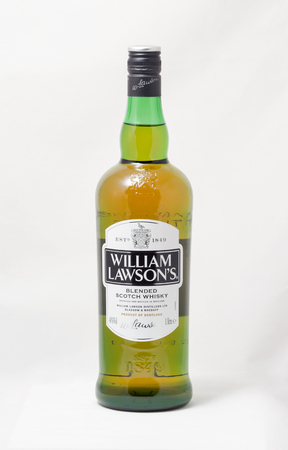 KIEV, UKRAINE - OCTOBER 26, 2014: William Lawsons blended Scotch Whisky bottle closeup on white background. William Lawson distillery was founded in 1849. Editorial