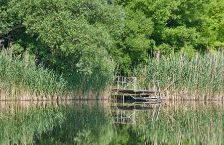 Old wooden bridge for river fishing. River Ros, Central Ukraine.