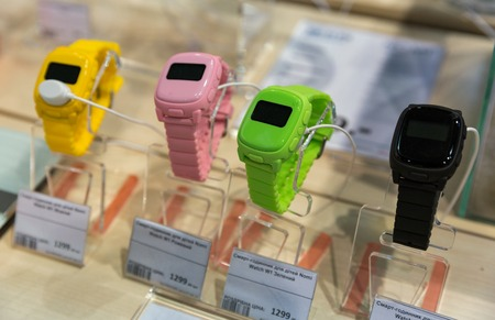 KIEV, UKRAINE - APRIL 07, 2017: Nomi Chinese company smart watches for children booth at 2nd International Trade Show of Electric and Hybrid Vehicles Plug-In Ukraine in KyivExpoPlaza venue.