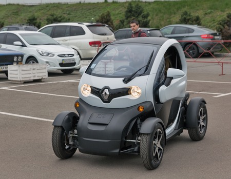 ze: KIEV, UKRAINE - APRIL 07, 2017: Renault Twizy Z.E. electric car outdoor at 2nd International Trade Show of Electric and Hybrid Vehicles Plug-In Ukraine in KyivExpoPlaza venue.