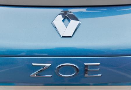 ze: KIEV, UKRAINE - APRIL 07, 2017: Renault Zoe electric hybrid car logo closeup at 2nd International Trade Show of Electric and Hybrid Vehicles Plug-In Ukraine in KyivExpoPlaza venue.