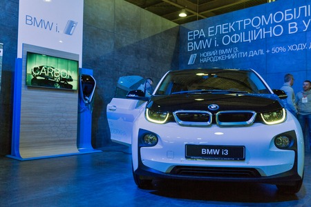 i3: KIEV, UKRAINE - APRIL 07, 2017: People visit BMW i3 hybrid car booth at 2nd International Trade Show of Electric and Hybrid Vehicles Plug-In Ukraine in KyivExpoPlaza venue.