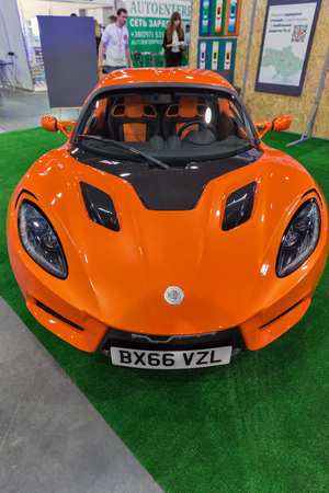 KIEV, UKRAINE - APRIL 07, 2017: People visit booth with Detroit Electric sport car at 2nd International Trade Show of Electric and Hybrid Vehicles Plug-In Ukraine in KyivExpoPlaza venue.