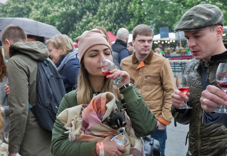 KIEV, UKRAINE - MAY 13, 2017: Unrecognized people taste wine during Kyiv Food and Wine Festival in National Expocenter, a permanent multi-purpose exhibition complex in the Teremky neighborhood.