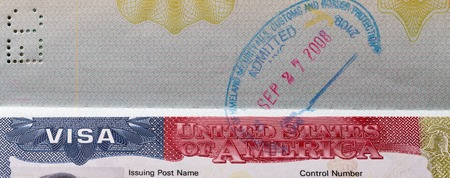 American Visa with stamp in the passport closeup Stock Photo