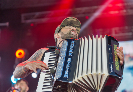 KIEV, UKRAINE - JUNE 28, 2017: Popular Ukrainian rock band Kozak System and its frontman, vocalist and accordionist Ivan Lenio performs at the Atlas Weekend Festival in National Expocenter.