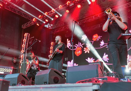 KIEV, UKRAINE - JUNE 28, 2017: Popular Ukrainian rock band Kozak System: guitarist Demyanenko, bass guitarist Sherstyuk and trumpeter Solovy performs at the Atlas Weekend Festival in Expocenter