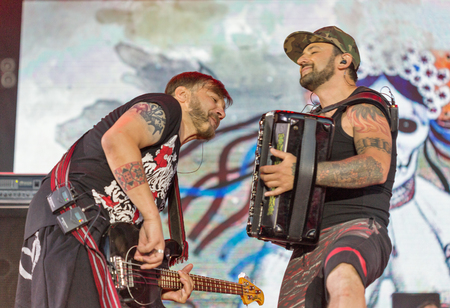 KIEV, UKRAINE - JUNE 28, 2017: Ukrainian rock band Kozak System and its frontman, vocalist and accordionist Lenio with bass guitarist Sherstyuk performs at the Atlas Weekend Festival in Expocenter.
