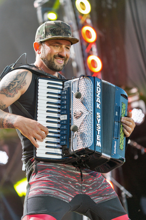 vocalist: KIEV, UKRAINE - JUNE 28, 2017: Popular Ukrainian rock band Kozak System and its frontman, vocalist and accordionist Ivan Lenio performs at the Atlas Weekend Festival in National Expocenter.