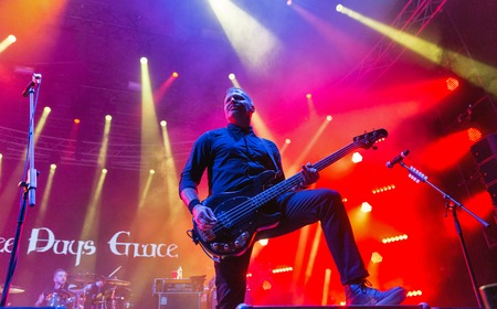 voices: KIEV, UKRAINE - JUNE 29, 2017: Popular Canadian post grunge rock band Three Days Grace and its bass guitarist Brad Walst performs at the Atlas Weekend Festival in National Expocenter. Editorial