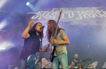 electronic music: KIEV, UKRAINE - JULY 02, 2017: Ukrainian stoner rock band Stoned Jesus and its guitarist Igor Sydorenko and bass guitarist Sergii Sliusar performs live at the Atlas Weekend Festival in National Expocenter.