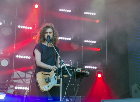 lead guitar: KIEV, UKRAINE - JULY 02, 2017: Rock band Sinoptik, winner Global Battle of the Bands 2016, and its frontman and guitarist Dmitriy Afanasyev performs live at the Atlas Weekend Festival in Expocenter.