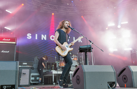 electronic music: KIEV, UKRAINE - JULY 02, 2017: Rock band Sinoptik, winner Global Battle of the Bands 2016, and its frontman and guitarist Dmitriy Afanasyev performs live at the Atlas Weekend Festival in Expocenter.