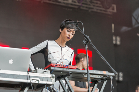KIEV, UKRAINE - JUNE 29, 2017: Popular Ukrainian experimental electro folk band ONUKA and its keyboardist and backing vocalist Daryna Sert live performs at the Atlas Weekend Festival in Expocenter.