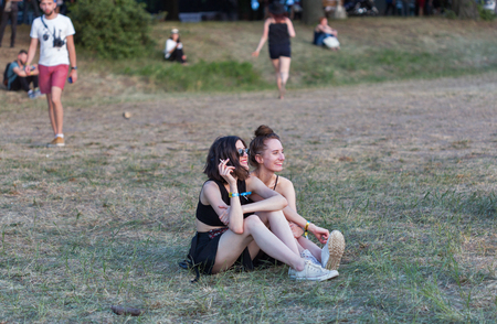 KIEV, UKRAINE - JUNE 29, 2017: Young fans visit music concert outdoors at the Atlas Weekend music festival in National Expocenter. Фото со стока - 82644971