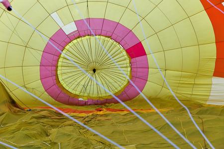 Yellow hot air balloon inside, prepairing to flight