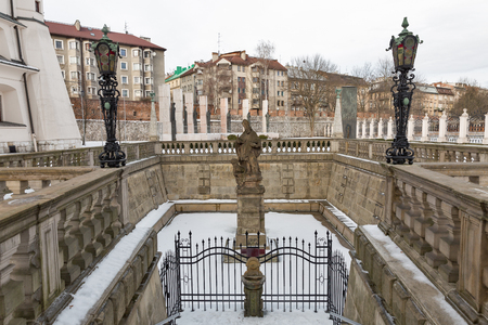 Pauline Church on the Rock inner courtyard on Vistula riverbank in Jewish district Kazimierz. Krakow, Poland. 8th century catholic church and religious sanctuary with baroque decor and a burial crypt. Stock Photo