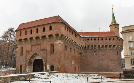 Military medieval building Barbican at winter in Krakow, Poland
