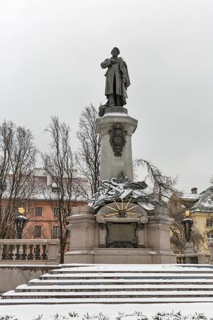 Monument of great Polish poet Adam Mickiewicz in winter. Warsaw, Poland.