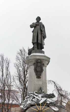 WARSAW, POLAND - JANUARY 16, 2017: Monument of great Polish poet Adam Mickiewicz in winter. Warsaw is the capital and largest city of Poland. Editorial