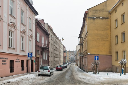 RZESZOW, POLAND - JANUARY 17, 2017: Cars parked along Baldachowka winter street in city center. It is the largest city in southeastern Poland located on Wislok River in Sandomierz Basin.