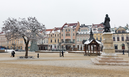 RZESZOW, POLAND - JANUARY 17, 2017: People walk along winter Market square in front of City Hall. Rzeszow is the largest city in southeastern Poland, located on Wislok River in Sandomierz Basin.