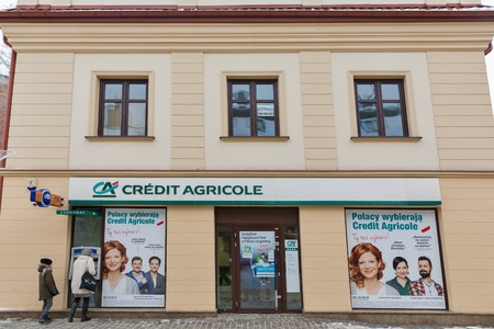 RZESZOW, POLAND - JANUARY 17, 2017: Unrecognized people visit Credit Agricole bank in city center. Rzeszow is the largest city in southeastern Poland, located on Wislok River in Sandomierz Basin. Editorial
