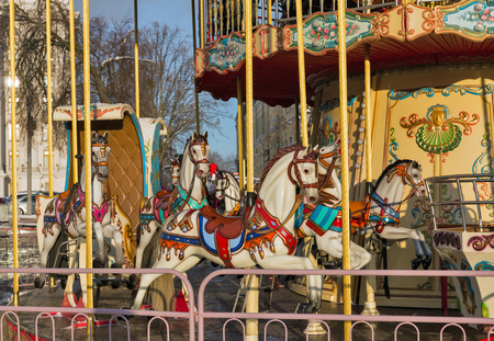play the old park: Vintage carousel horses closeup outdoor in winter