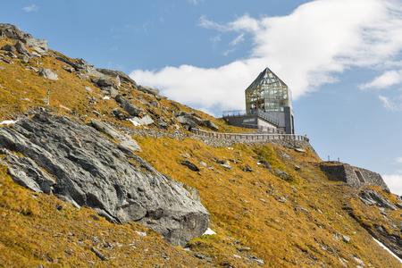 Mountain side with Wilhelm Swarovski Observation Tower on Kaiser Franz Joseph glacier. Grossglockner High Alpine Road in Austrian Alps.