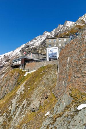 GROSSGLOCKNER, AUSTRIA - SEPTEMBER 23, 2017: Unrecognized people visit Gletscher restaurant, souvenir shop and the observation platform of Kaiser Franz Josef glacier. High Alpine Road in Austrian Alps.