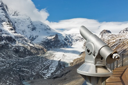 Observation point with telescope. Kaiser Franz Joseph glacier, Grossglockner High Alpine Road in Austrian Alps. Focus on background. Stock Photo